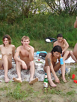 Beach party while people fuck at the nude beach